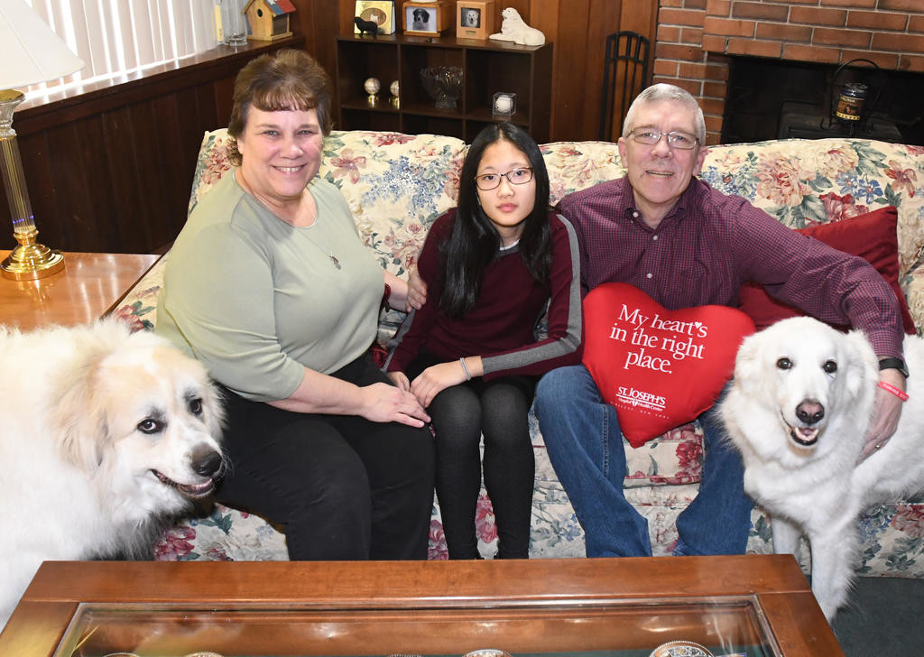 FAMILY WITH HEART — The Benham family, Roy, right, and Grace, center, were chosen to be among the 2018 Red Cap Ambassadors for this year's America's Greatest Heart Run and Walk to take place at Utica College Friday and Saturday, March 2 and 3.  The family will also be at the Rome Indoor Run and registration event Saturday at Rome Free Academy.  Also joining them, from left: Bear, mom Nancy and Kayla, far right.  (Sentinel photo by John Clifford)