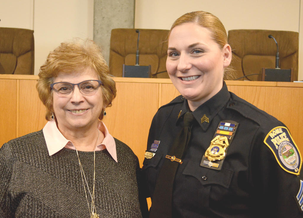 THEN AND NOW — Retired police sergeant Sandra L. Gerhardt, left, poses with newly promoted Sgt. Sharon L. Rood at a ceremony in City Hall earlier this month. They are the only two female officers in the history of the Rome Police Department to be promoted to sergeant, and they faced wildly different levels of discrimination due to their gender. (Sentinel photo by John Clifford)  (Sentinel photo by John Clifford)
