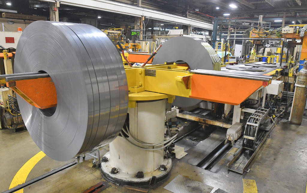 AWAITING PACKAGING — Slit coils are shown ready to be packaged at Worthington Industries' Rome faciltiy, whose products include cold rolled strip steel.  (Sentinel photo by John Clifford)