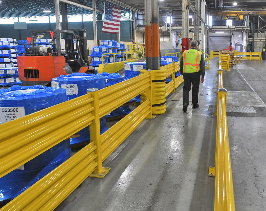 ADDED SAFETY MEASURES — Rails have been installed along walkways at the Worthington Industries facility in Rome as part of safety improvements.  (Sentinel photo by John Clifford)