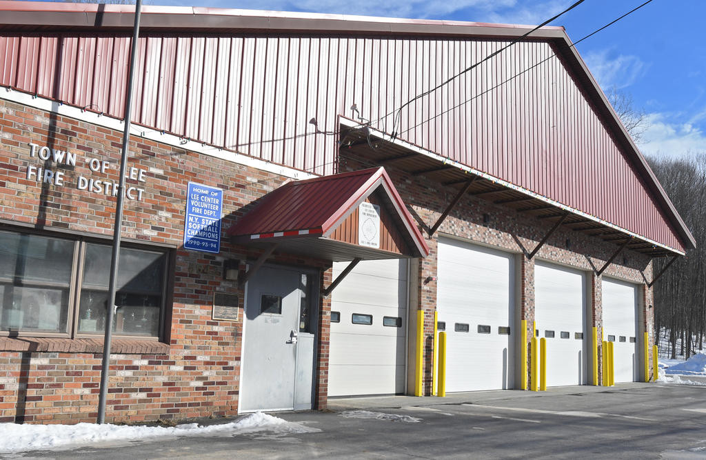 FIREHOUSE DOOR ISSUES — Three overhead doors at the Lee Center firehouse, shown here on the far right side of the building, are not functioning properly following a renovation project that reconfigured four doors into the three wider doors to better fit larger vehicles.  (Sentinel photo by John Clifford)