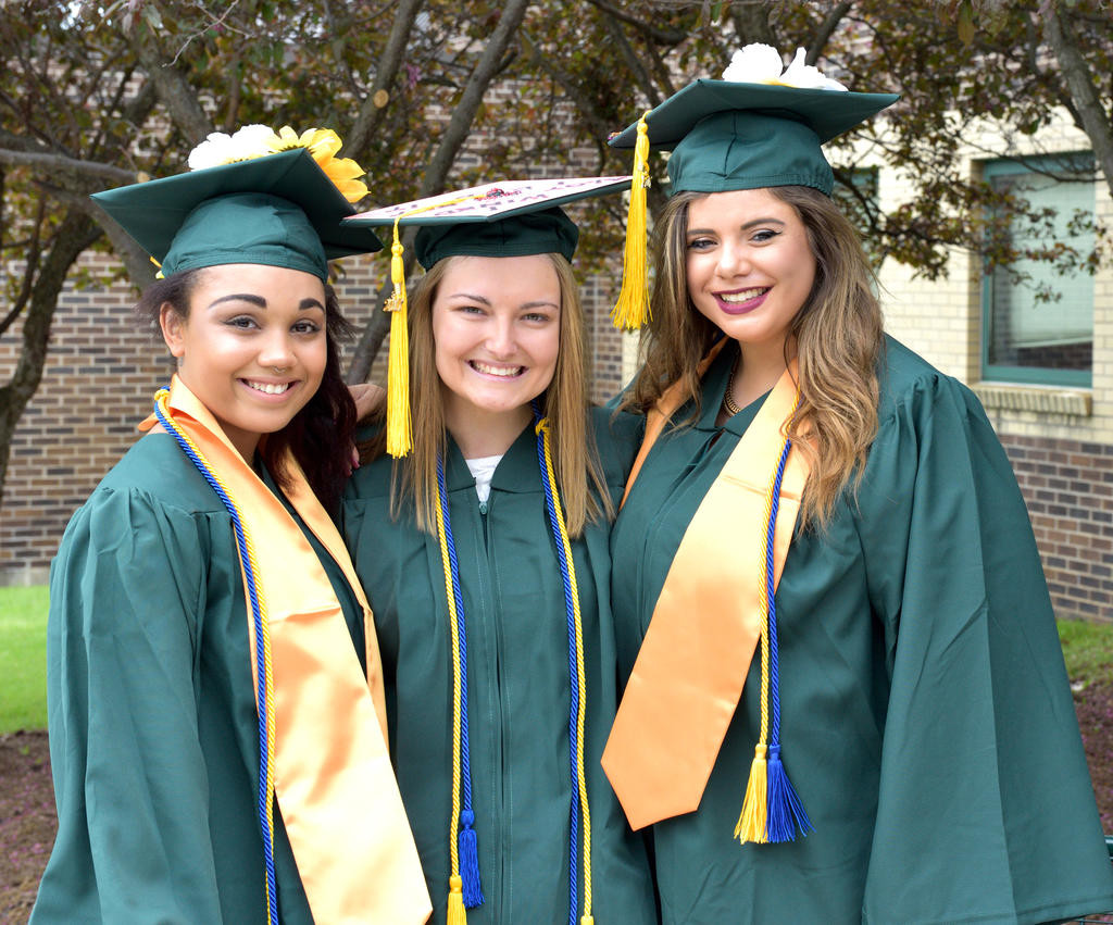 GRADUATES — Students pose before Herkimer County Community College's 49th commencement last May. The school awarded associates degrees to 423 students and certificates to 20.  (Photos submitted)