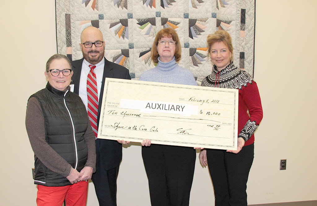 HOSPITAL HELP — The Community Memorial Hospital Auxiliary receives a $10,000 check from the Share the Care Gala.  From left: Mary Brundage, co-chair of the 2018 Share in the Care Gala; President and CEO of Community Memorial Sean Fadale; Leslie Lollman, Treasurer of Hospital Auxiliary; and Julie Rubenstein, co-chair of 2018 Share in the Gala and Vice President of Community Memorial Foundation Board.  (Photo submitted)