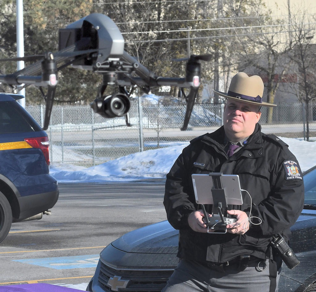 UP, UP AND AWAY — The camera on the front of this new state police drone will help document natural disasters, crime scenes and, in time, motor vehicle accidents. Sgt. David Olney is the pilot.  (Sentinel photo by John Clifford)