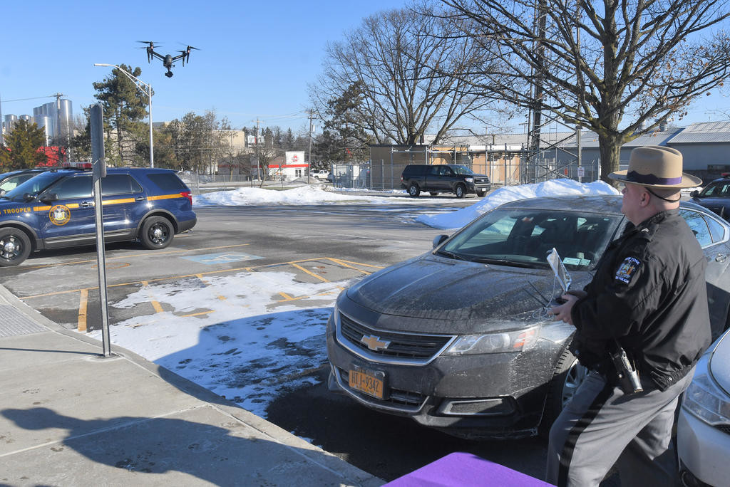 TEST FLIGHT — State Police Sgt. David Olney takes the new drone out for a spin over the Troop D Headquarters parking lot in Oneida on Friday.  (Sentinel photo by John Clifford)