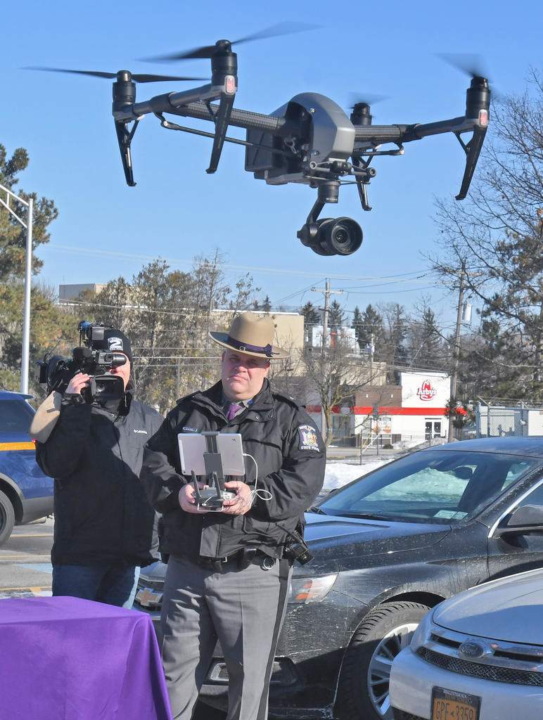 OUT FOR A SPIN — State Police Sgt. David Olney takes the new drone out for a spin over the Troop D Headquarters parking lot in Oneida on Friday.  (Sentinel photo by John Clifford)