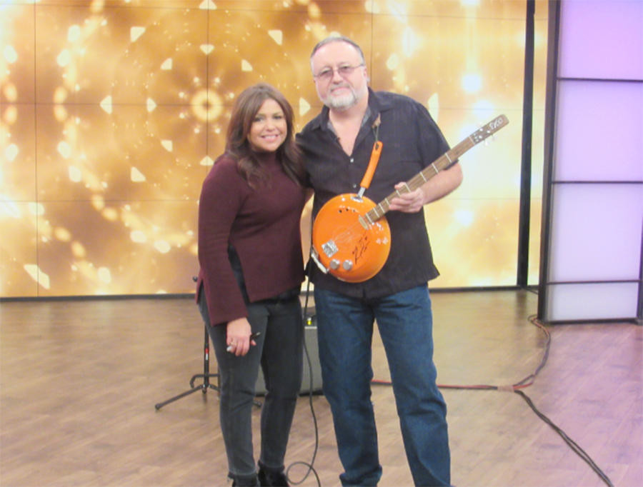 "OUT OF THE FRYING PAN — Terry ""Mojo"" Johnson of the Swamp Drivers displays his frying-pan shaped guitar during a recent appearance on the ""Rachael Ray Show."" The Swamp Drivers will perform a free concert this Friday at Oneida's Kallet Civic Center, 159 Main. St., Oneida, at 8 p.m.  (Photo submitted)"