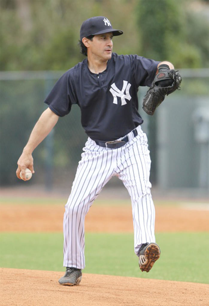 DEALING — Mike Froio deals a pitch during a game at the New York Yankees Fantasy Camp.  (Photo submitted)