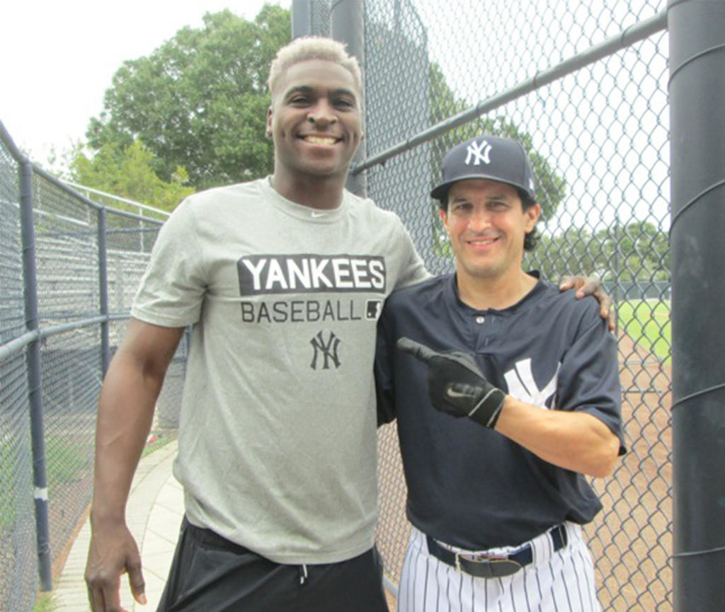 TWO OF A KIND — Current New York Yankees shortstop Didi Gregorius and Rome native Mike Froio pose for a picture during the Yankees Fantasy Camp.  (Photo submitted)