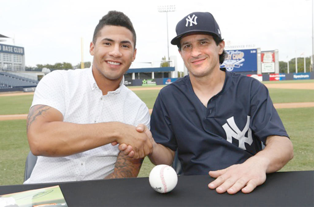 SUPERSTAR IN THE MAKING — New York Yankees prospect Gleyber Torres, left, poses with Mike Froio during the Yankees Fantasy Camp.