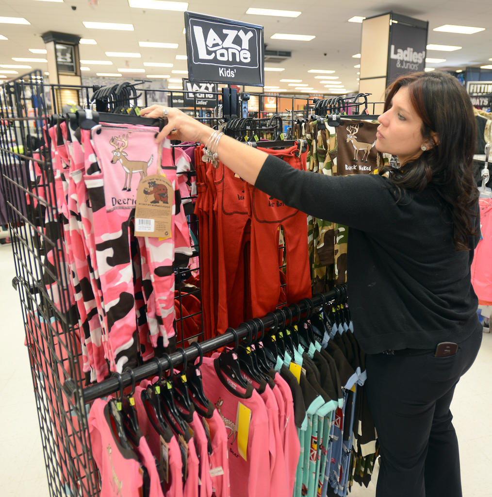 COZY KIDS — A store manager of Herb Philipson's Rome location, stocks Lazy One kids items on a display rack in this 2015 file photo. Company officials said the family-owned, nine-store retain chain is up for sale. The 67-year-old company was started in Rome in 1951 when 'Herb' Philipson opened his first store.  (Sentinel file photos by John Clifford)