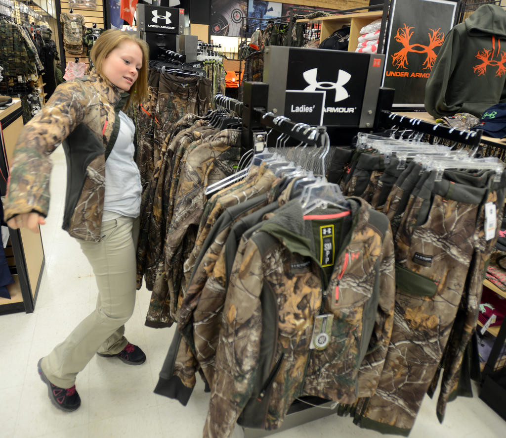 ON DISPLAY — A popular item at 'Herb' Philipson's in Rome is Under Armour's ladies camouflage outdoor apparel. A Sporting Department associate tries on a jacket in this 2015 file photo.  (Sentinel photo by John Clifford)
