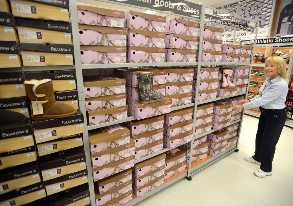 PLENTY OF SHOES — A department manager at Herb Philipson's moves around RealTree womens camo boots at the Rome location in this 2015 file photo.  (Sentinel photo by John Clifford)