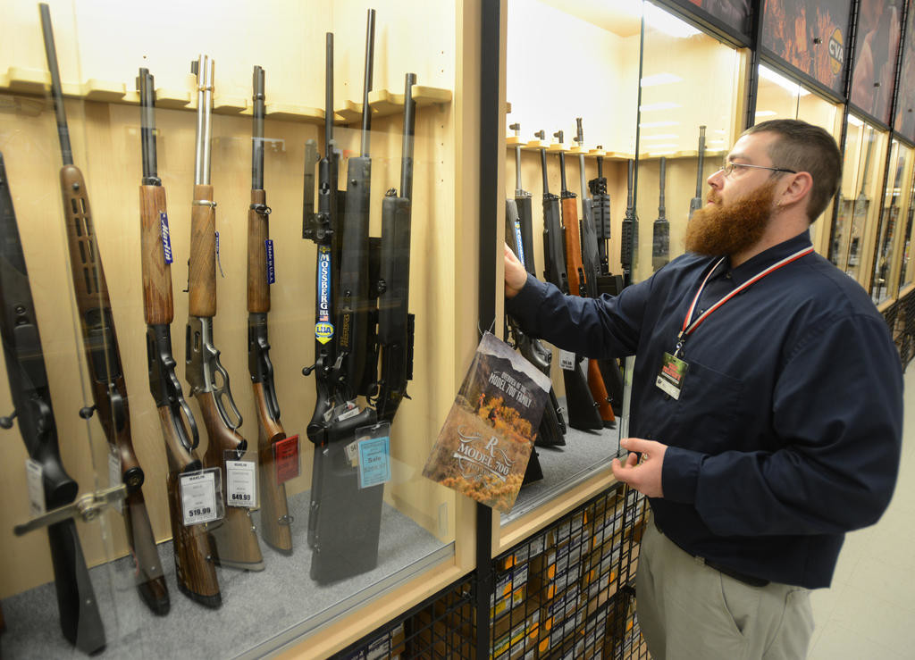 A REVIEW — An associate at Herb Philipson's in the Sporting Department, reviews the selection of firearms at the Rome location in this 2015 file photo. The company has faced a growing number of chain stores offering many similar products in recent years as well as increased competition from online stores.  (Sentinel photo by John Clifford)