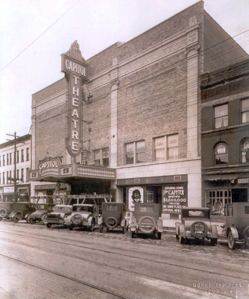BRING IT BACK — This view of the Capitol Theatre from early December 1928, shortly before the Dec. 10 opening, shows the vertical sign above the marquee. The theater is proposing to add a similar lighted vertical sign back on the building to extend slightly above it.