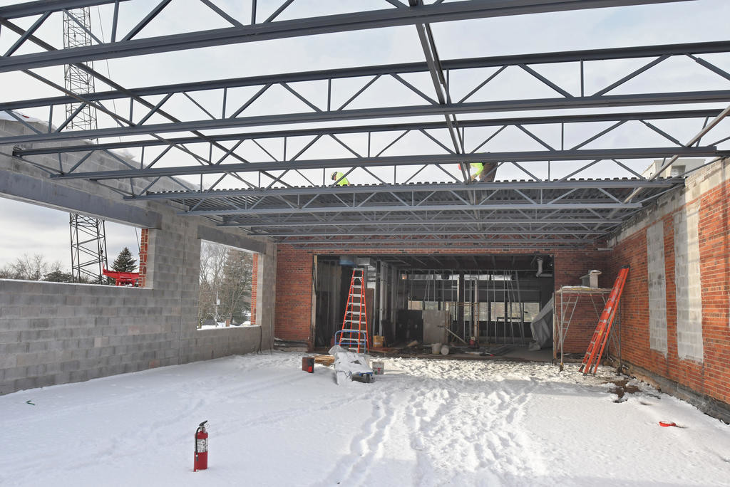 READYING FOR ROOF — With recent snowfall visible on the floor, preparations are being made to complete a roof over a small addition on the second floor of Strough Middle School's 801 Laurel St. building. A school district official says the goal continues to be for an on-time completion of the project.