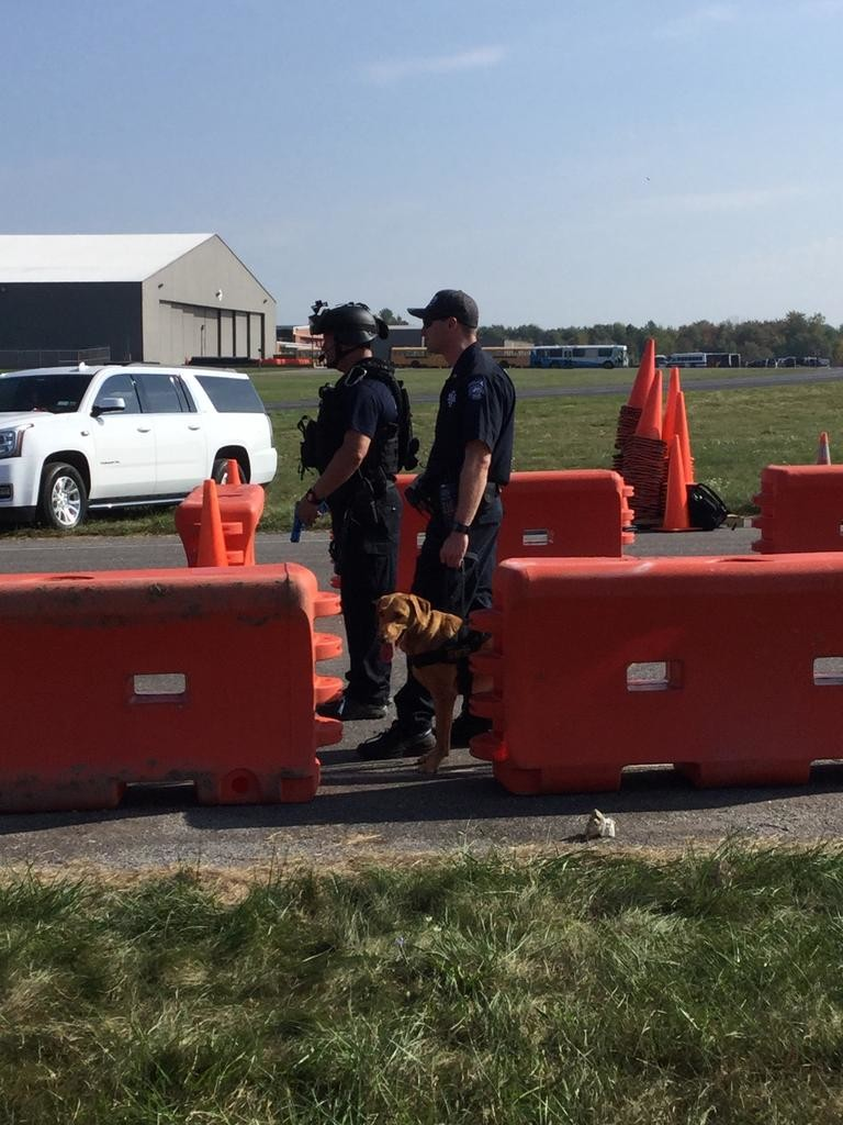 GOOD BOY — A police K-9 patiently waits his turn to sniff out a potential bomb at a vehicle checkpoint training scenario. Officials said that the dogs are told to treat the scenario as real, so it's not mere training for them.  (Sentinel photo by Sean I. Mills)
