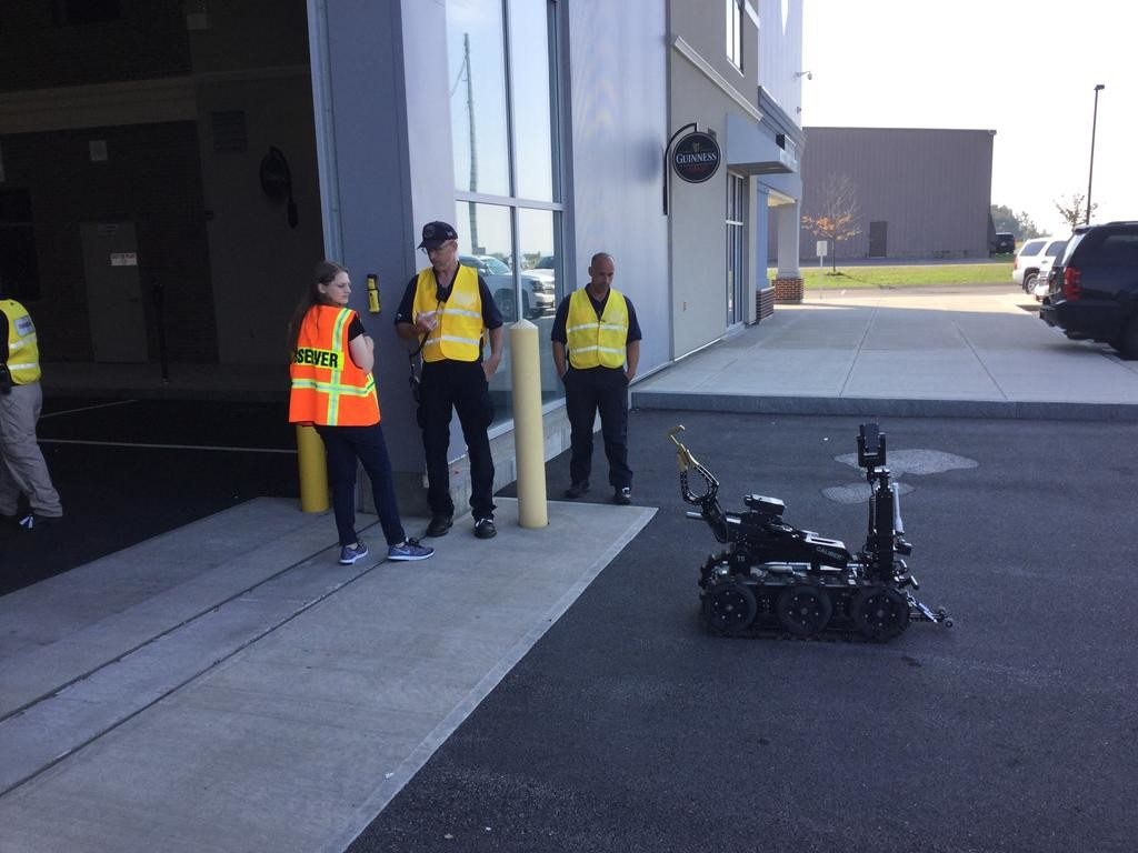 REPORTING FOR DUTY — A bomb disposal robot rolls up to a training session involving a hostage in a bomb vest. The session was held in the warehouse-sized Cityscape at the State Preparedness Center in Whitestown.  (Sentinel photo by Sean I. Mills)