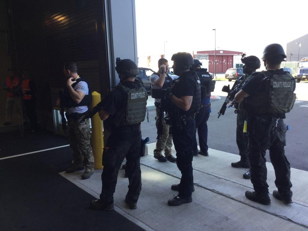 LOCKED AND LOADED — SWAT officers from across the state prepare for the next part of their training session at the Preparedness Center on Wednesday. This group included officers from the Syracuse Police and the Westchester County Police.  (Sentinel photo by Sean I. Mills)