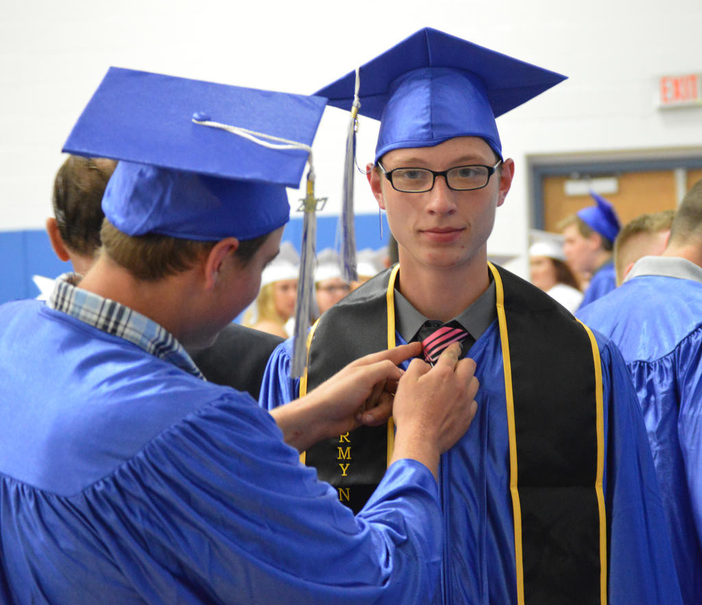 FIXING THE TIE — Nicolas Calabrese, left, fixes Cory Ouimet's tie before the Camden Central School commencement ceremony on Friday night. More from the ceremony on pages 2 and 10.  (Sentinel photo by Kenny Kudrewicz)