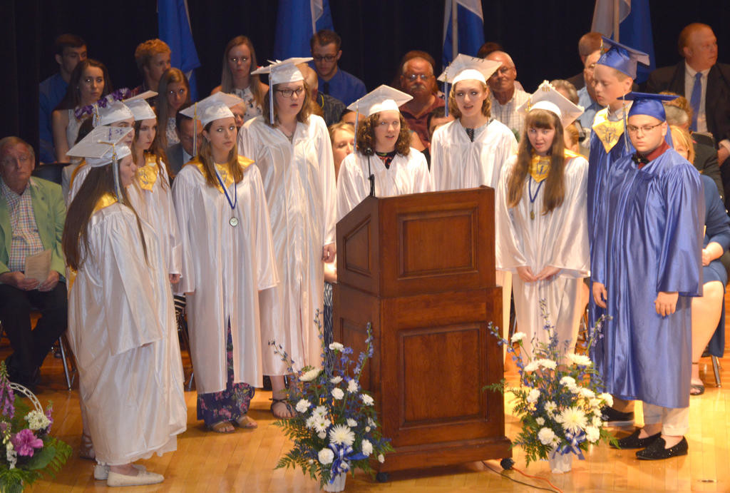 "BELTING IT OUT — The Camden High School Senior Choral Ensemble sings Michael Jackson's ""Man In The Mirror"" during Friday night's 129th annual commencement ceremony.  (Sentinel photo by Kenny Kudrewicz)"