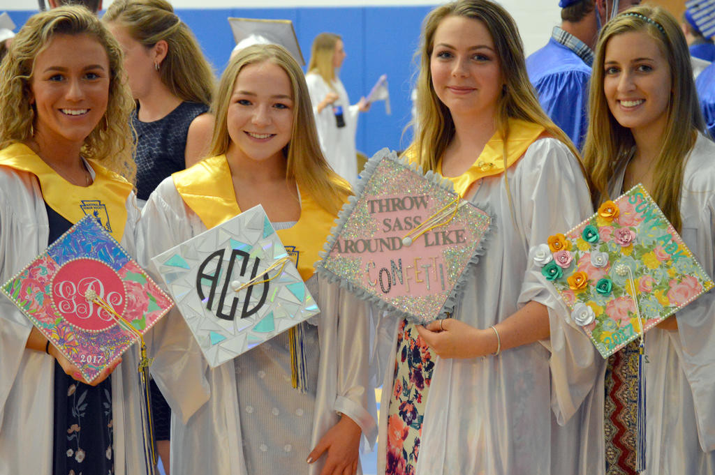 DECORATED CAPS — Gabriella Prusack, Abby Carpenter, Katilin Cook and Kennedy Steria pose with their decorated caps before the 129th annual Camden Commencement ceremony on Friday night.  (Sentinel photo by Kenny Kudrewicz)