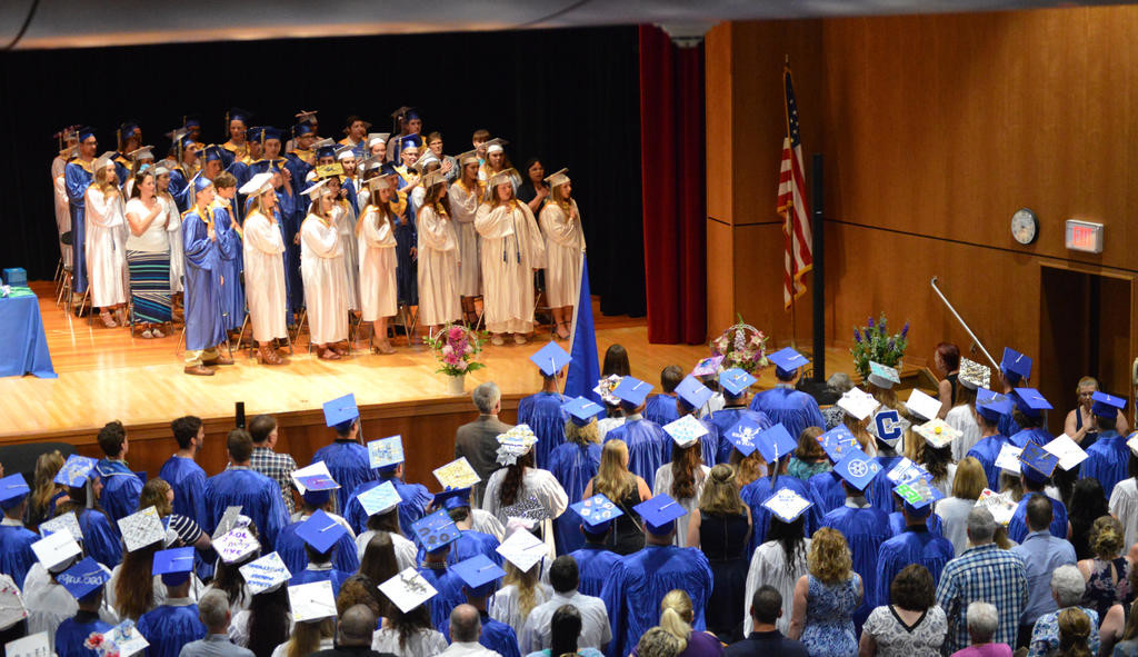 PLEDGING ALLEGIANCE — An overview of the Camden graduation ceremony reciting the Pledge of Allegiance inside the Camden High School auditorium on Friday night. The ceremony was moved inside due to the threat of inclement weather.  (Sentinel photo by Kenny Kudrewicz)