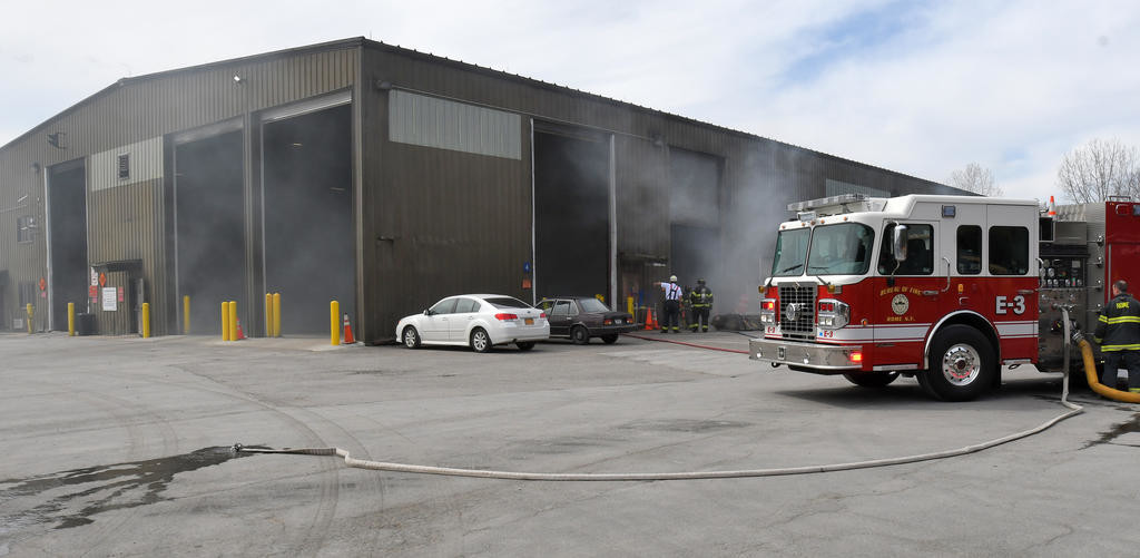 BURNING INSIDE — Smoke puffs out of the Western Transfer Station on Perimeter Road while the garbage burns inside.  (Sentinel photo by John Clifford)