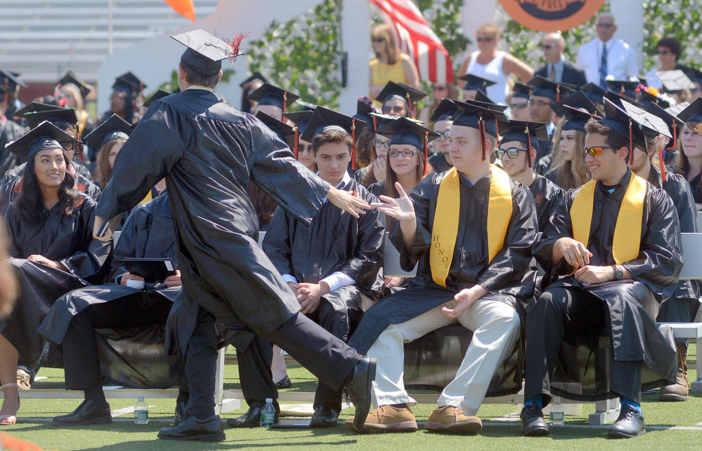 Jacob Webb gets fives as he runs by them after getting his diploma  (Sentinel photo by John Clifford)
