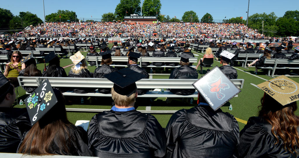RFA graduating seniors and the sun splashed crowd at RFA Stadium  (Sentinel photo by John Clifford)