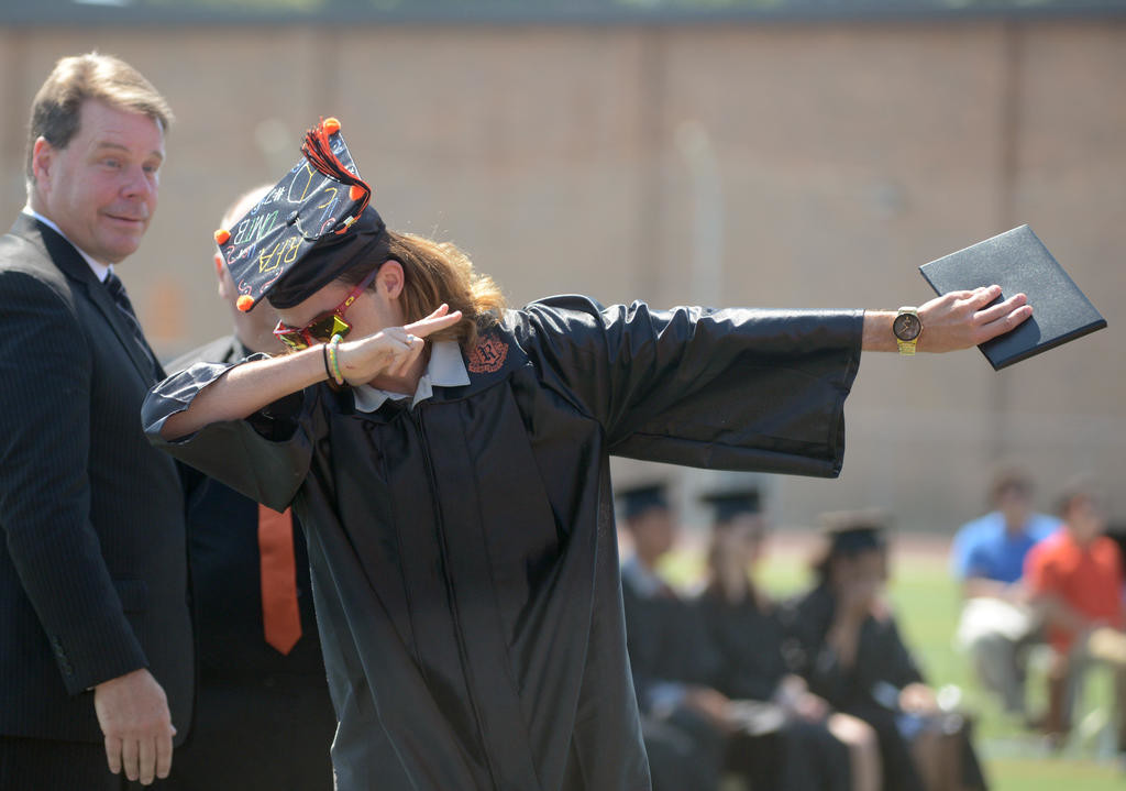 Ethan Hall reacts to getting his diploma  (Sentinel photo by John Clifford)