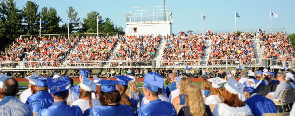 CROWDED HOUSE — The class of 2016 in Camden takes part in the 128th annual commencement ceremony Friday while friends and families packed the stands of the football stadium. There were 164 graduating seniors.  (Sentinel photo by Makenzi Enos)