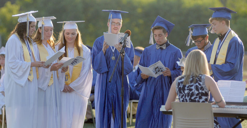 "CELEBRATING WITH SONG — The senior choral ensemble at Camden Central High School singing ""Hakuna Matata"" at Friday's graduation ceremony.  (Sentinel photo by Makenzi Enos)"