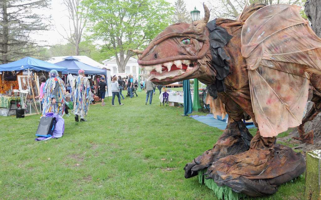"STANDING GUARD — A ""life-size"" dragon puppet overlooks the vendor grounds in the Holland Patent Village Park during the Mayfaire event on Saturday.  (Sentinel photos by Makenzi Enos)"