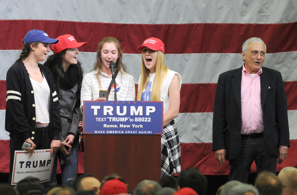 Trump supporters singing God Bless America  (Sentinel photo by John Clifford)