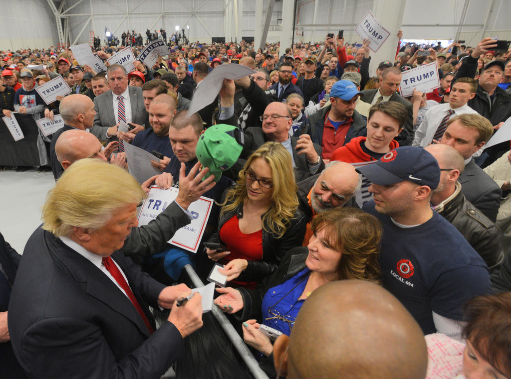 Trump signing after the rally  (Sentinel photo by John Clifford)