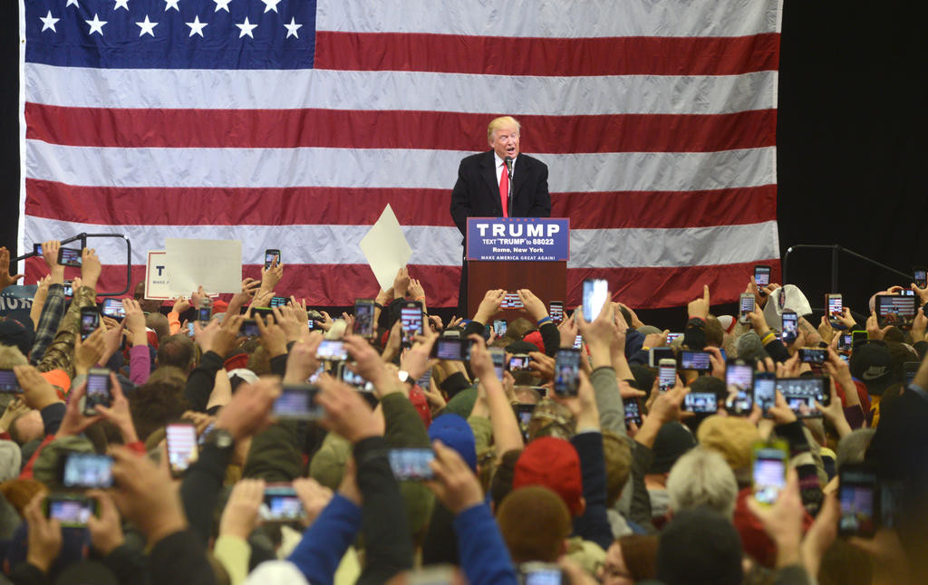 Trump on stage with all his supporters and their cell phones out.  (Sentinel photo by John Clifford)