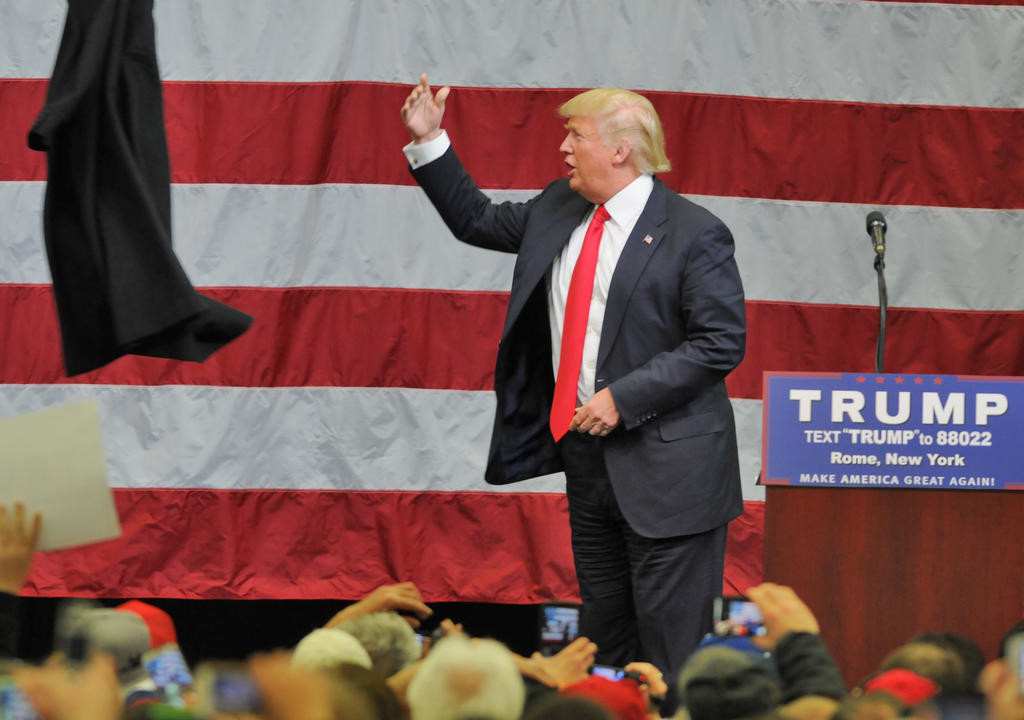 Trump flings his over coat off after a couple minutes of talking  (Sentinel photo by John Clifford)