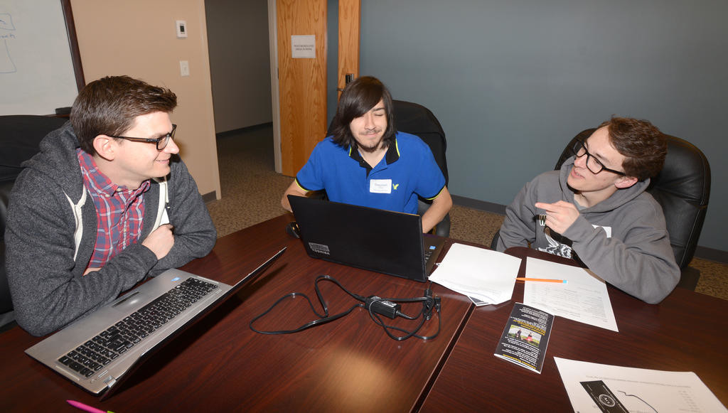 TRYING FOR ANOTHER WIN — Westmoreland high school seniors Stephen Cosco and Matthew Calogero work on privacy and security programming topics this morning with Westmoreland math teacher Nick Darrah, at left, during the annual Challenge Competition event at the Griffiss Institute. The two students were the winners last year. An awards ceremony for this year's competition will be held Friday.  (Sentinel photo by John Clifford)