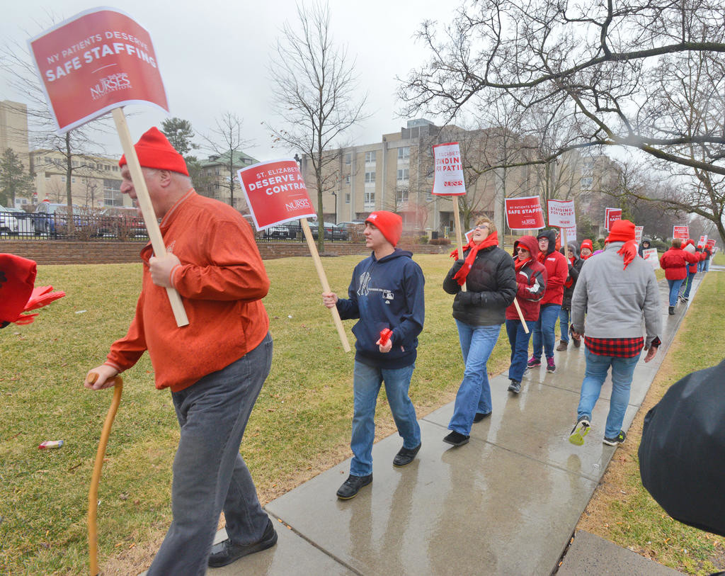 UNION RALLY — Members of the New York State Nurses Association at St. Elizabeth Medical Center held a noontime rally Friday outside the Utica health care facility. The last SEMC contract with the union expired June 30, nearly nine months ago.  (Sentinel photo by John Clifford)
