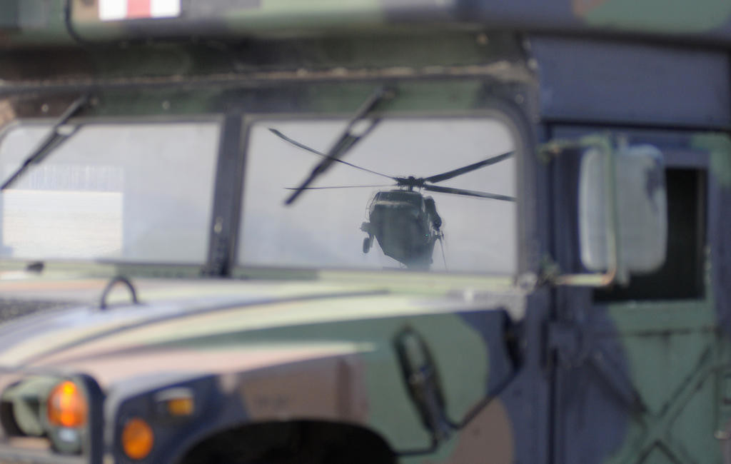 Relfection of the Blackhawk in the windshield of a military vehicle.  (Sentinel photo by Makenzi Enos)