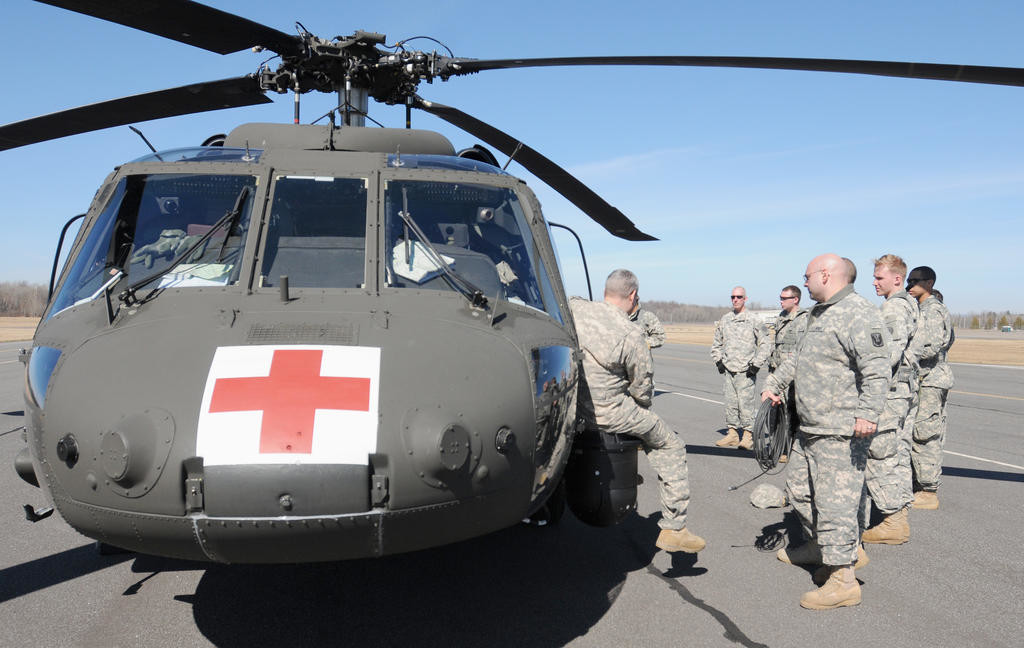 Front of the Blackhawk with men leanring how to load patients into the helicopter.  (Sentinel photo by Makenzi Enos)