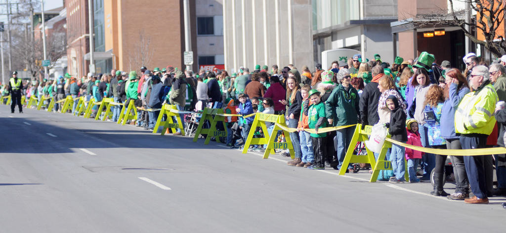 Spectators all along Genesee St waiting for the start of the 2016 Utica St. Patrick's Day parade.  (Sentinel photo by Makenzi Enos)