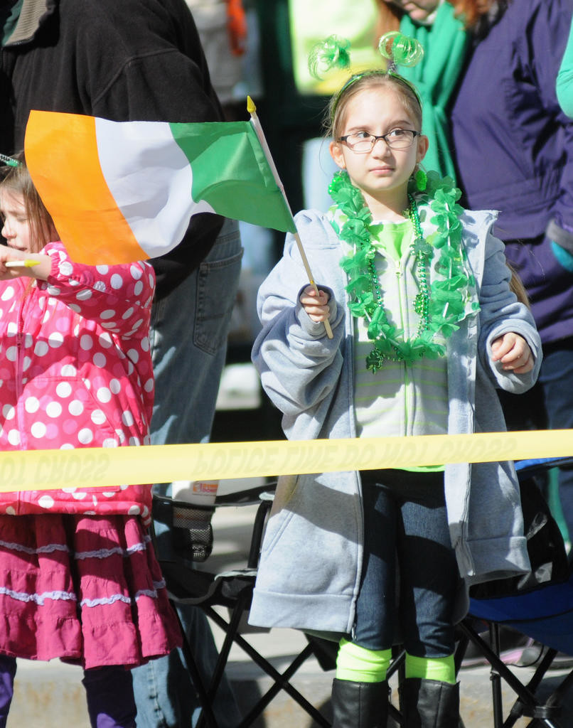 Rayna Niziol 8 daughter of Jamie Derella of Utica showing off her Irish pride before the start of the parade.  (Sentinel photo by Makenzi Enos)