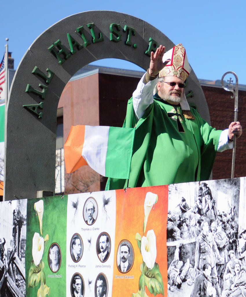 St. Patrick waving to the parade viewers.  (Sentinel photo by Makenzi Enos)