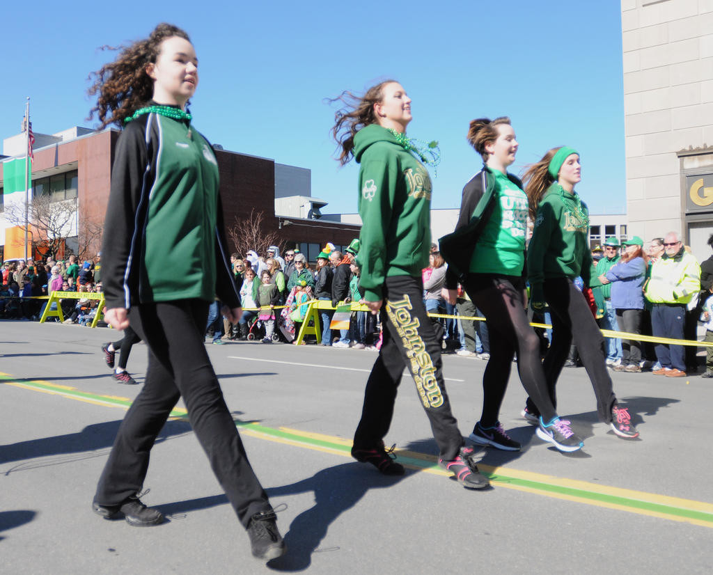 Dancers from the Johnston School of Irish Dance performing as they making their way along the parade route.  (Sentinel photo by Makenzi Enos)