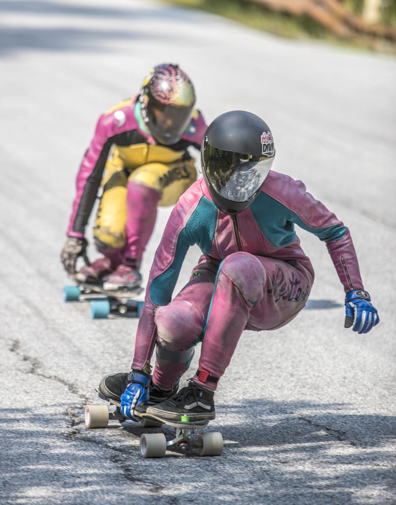 ZOOMING ALONG — Skateboarders race down a steep hill in this Gravity Fest file photo. Gravity Fest is returning to East Hill Road in Munnsville Saturday and Sunday, 16 years after its founding and three years after its most recent run.  (Photo submitted)