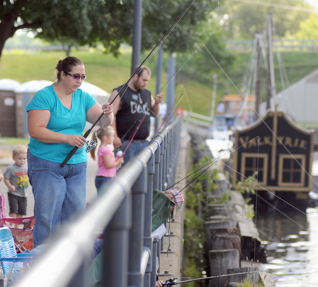 Fishing lines dangle from the side of the canal during the fishing derby Saturday morning.  (Sentinel photo by Makenzi Enos)