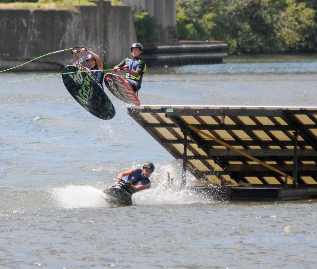 Two knee boarders jumping off of the ramp and over the other.  (Sentinel photo by Makenzi Enos)