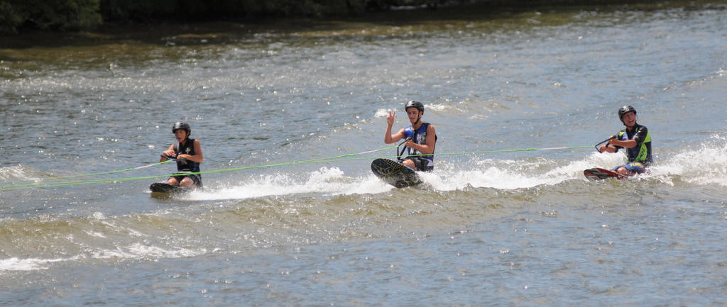 Camp Mohawk Valley X-Squad knee boarders in the canal waters for their water show.  (Sentinel photo by Makenzi Enos)